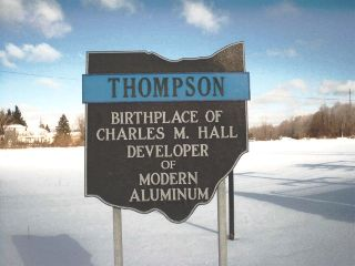 Sign commemorating Charles Martin Hall located south of town square.
